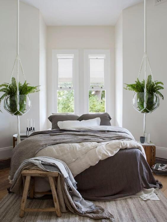 Bedroom with indoor hanging plants