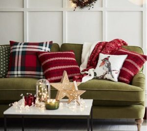 Christmas interior, Green sofa with Christmas scatters